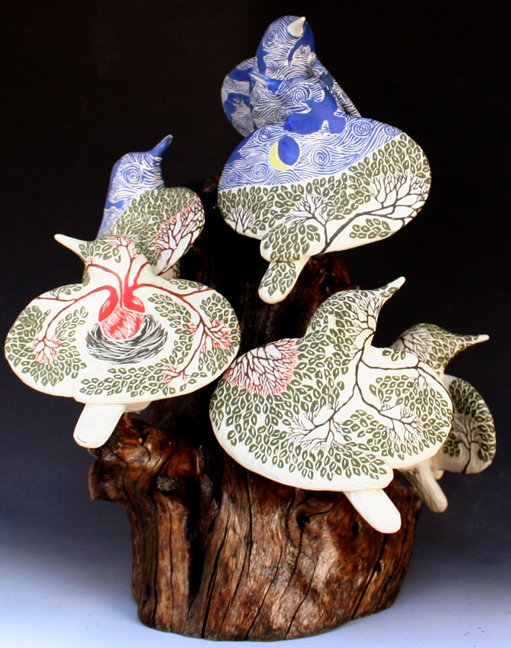cathy weber - art - clay - woman - montana - ceramic - porcelain - bird - red wing - phases - forest - carved - moon - tree - hand - heart