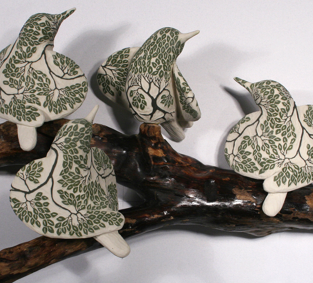 cathy weber - art - clay - woman - montana - ceramic - porcelain - bird - red wing - phases - forest - carved -forest - tree