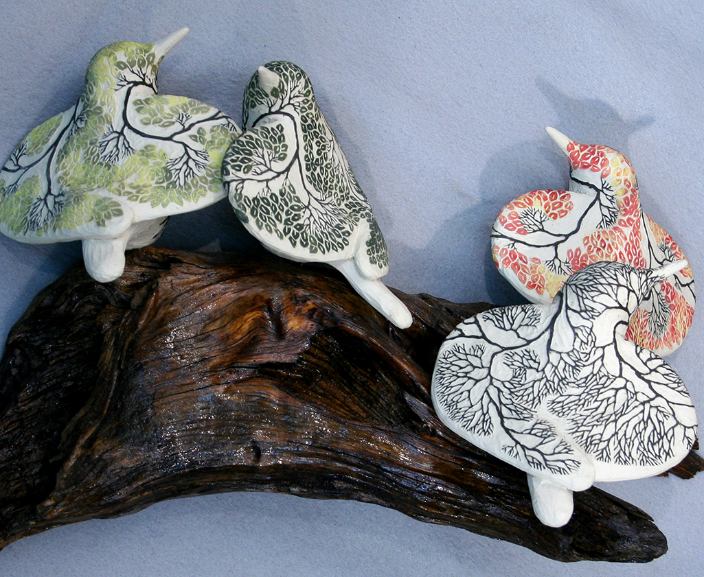 cathy weber - art - clay - woman - montana - ceramic - porcelain - bird - red wing - phases - forest - carved -forest - tree - seasons - fall - winter - spring - summer