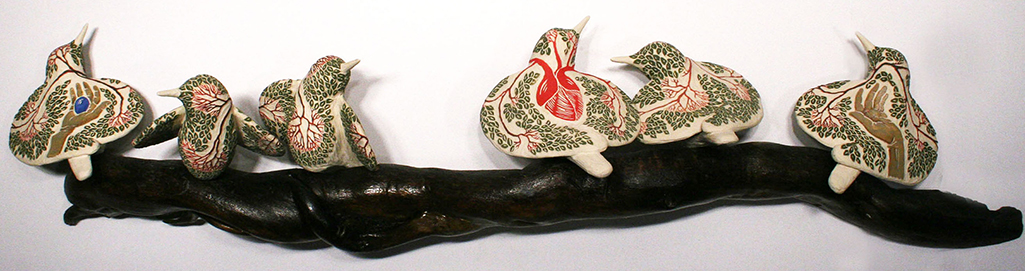 cathy weber - art - clay- woman - montana - ceramic - porcelain - bird - red wing - redwing - forest - carved - heart - tree - hand